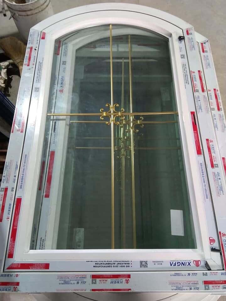 Mẫu cửa nhôm xingfa kính hộp có nan đồng trang trí
